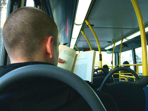 reading a book on a bus