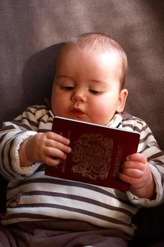 baby holding passport
