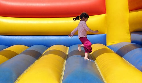 girl jumping in bouncy castle