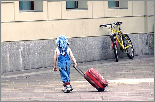 kid with rolling suitcase