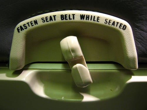 fasten seat belt while seated